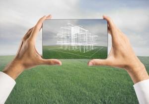 bigstock-Architect-Showing-New-House-Pr-50513648